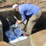 The Water Project: Mahira Community, Anunda Spring -  Enjoying Flowing Water