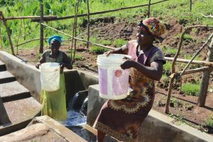 The Water Project:  Mounting Water On Her Head