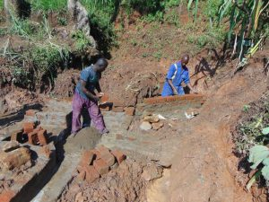 The Water Project:  Spring Wall Construction