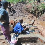 The Water Project: Indulusia Community, Yakobo Spring -  Pipe Setting