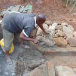 The Water Project: Indulusia Community, Yakobo Spring -  Stone Pitching Construction