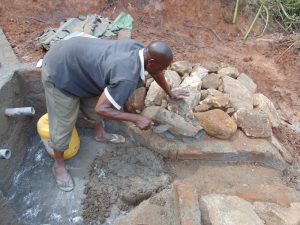 The Water Project:  Stone Pitching Construction