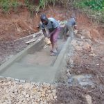 The Water Project: Indulusia Community, Yakobo Spring -  Cementing The Stairs