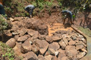 The Water Project:  Backfilling With Large Stones