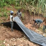 The Water Project: Indulusia Community, Yakobo Spring -  Fitting The Tarp
