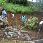 The Water Project: Indulusia Community, Yakobo Spring -  Soil Backfilling And Site Clearance