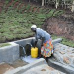 The Water Project: Indulusia Community, Yakobo Spring -  Collecting Water
