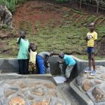 The Water Project: Indulusia Community, Yakobo Spring -  Happy Children Fetching Clean Water