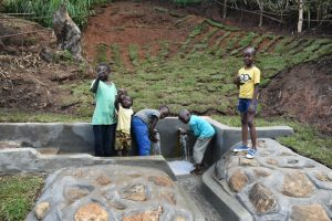 The Water Project:  Happy Children Fetching Clean Water