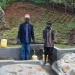 The Water Project: Indulusia Community, Yakobo Spring -  Mr Jacob Lumbasi And Isaiah Jacob