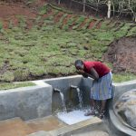 The Water Project: Indulusia Community, Yakobo Spring -  Mrs Jane Isaiah Drinking Clean Water