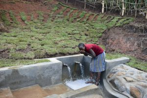 The Water Project:  Mrs Jane Isaiah Drinking Clean Water