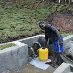 The Water Project: Indulusia Community, Yakobo Spring -  Fetching Clean Water