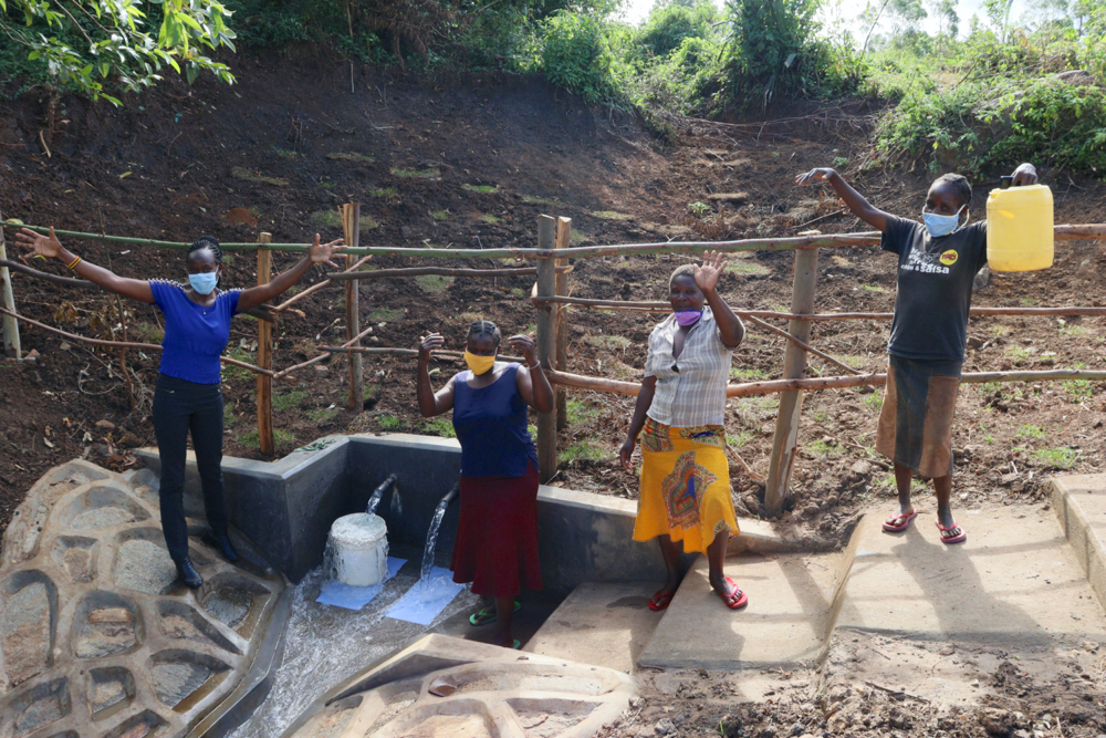 The Water Project : kenya20221-posing-at-the-spring-4