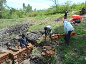 The Water Project:  Wing Wall Construction