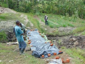 The Water Project:  Protecting Plaster From Oncoming Rainfall