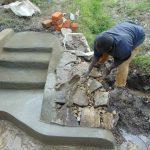 The Water Project: Lukala C Community, Livaha Spring -  Rub Wall Plaster