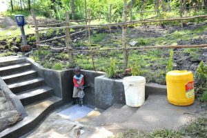 The Water Project:  Child At Completed Spring