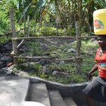 The Water Project: Lukala C Community, Livaha Spring -  Headed Home With Clean Water