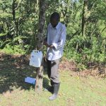 The Water Project: Lukala C Community, Livaha Spring -  Tying Leaky Tin On A Tree