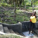 The Water Project: Lukala C Community, Livaha Spring -  Mounting Water On Her Head