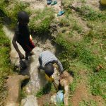 The Water Project: Muyundi Community, Magana Spring -  Collecting Water