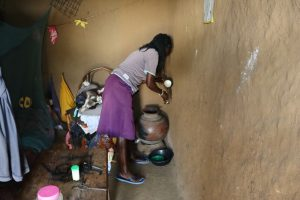 The Water Project:  Taking A Drink From The Water Pot