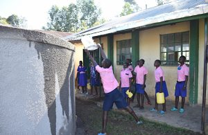 The Water Project:  Students Help Cure Rain Tank Cement At Training