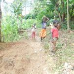 The Water Project: Mukhweso Community, Shemema Spring -  Kids Carry Rocks To The Spring For Use