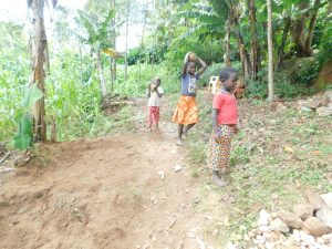The Water Project:  Kids Carry Rocks To The Spring For Use
