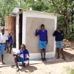 The Water Project: Jamulongoji Primary School -  Boys Posing At Their Latrines