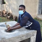 The Water Project: ACK St. Peter's Khabakaya Secondary School -  Team Leader Emmah Nambuye Tries Out The Added Handwashing Sinks