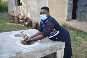 The Water Project:  Team Leader Emmah Nambuye Tries Out The Added Handwashing Sinks