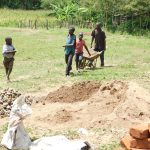 The Water Project: Emusaka Community, Muluinga Spring -  Children Help Carry Materials To Construction Site