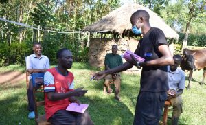 The Water Project:  Protus Hands Out Training Workbooks