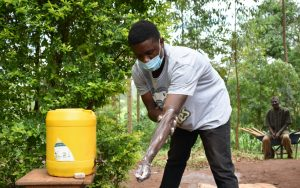 The Water Project:  Trainer Julius Shows The Correct Steps Of Handwashing