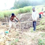 The Water Project: Emusaka Community, Muluinga Spring -  Putting Up The Fence