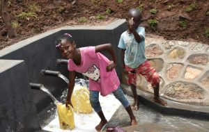 The Water Project:  Kids Pose At The Spring