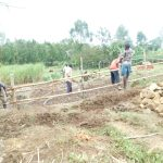 The Water Project: Emusaka Community, Muluinga Spring -  Fencing In The Catchment Area
