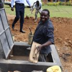 The Water Project: Jamulongoji Primary School -  Artisan Constructing Drawing Point