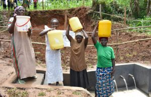 The Water Project:  Women Fetch Water At The Spring