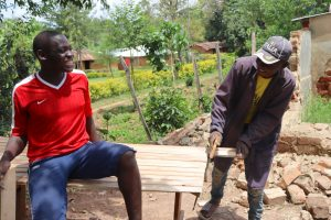 The Water Project:  Cutting Latrine Door