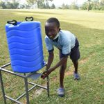 The Water Project: Isango Primary School -  A Student Washing Hands