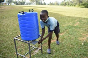The Water Project:  A Student Washing Hands