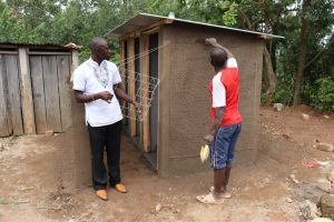 The Water Project:  Field Officer Erick Inspects The Artisans Work