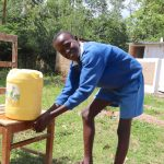 The Water Project: Jamulongoji Primary School -  Nelad Washing Hands After Using The Latrine