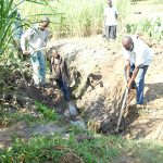 The Water Project: Emusaka Community, Muluinga Spring -  Clearing The Drainage Channel