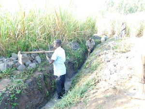 The Water Project:  Deepening The Drainage Channel