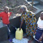 The Water Project: Emusaka Community, Muluinga Spring -  Fetching Clean Water