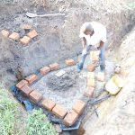 The Water Project: Emusaka Community, Muluinga Spring -  Bricklaying Begins